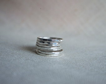 Sterling silver, hammered stacking rings.Set of 7.