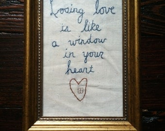 Embroidered Paul Simon Graceland quote in frame