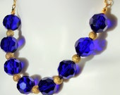 30.5 Inch Faceted Royal Blue Glass Bead Necklace with Gold Dusted Accents on a Gold Chain