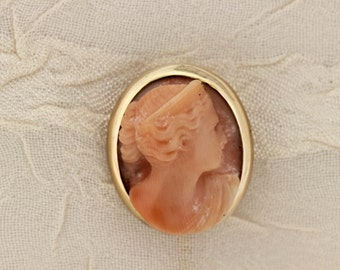 14K Stick pin with light Peach Coral Carved Female bust Bezel set