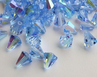 Rare Vintage Swarovski Beads, 20 Vintage Crystal Beads, Light Sapphire Art. 5400 6.6x6mm With AB Finish