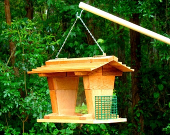 A suet feeder and bird seed feeder in one unique package! This big hopper style birdfeeder can be a hanging bird feeder or pole mounted