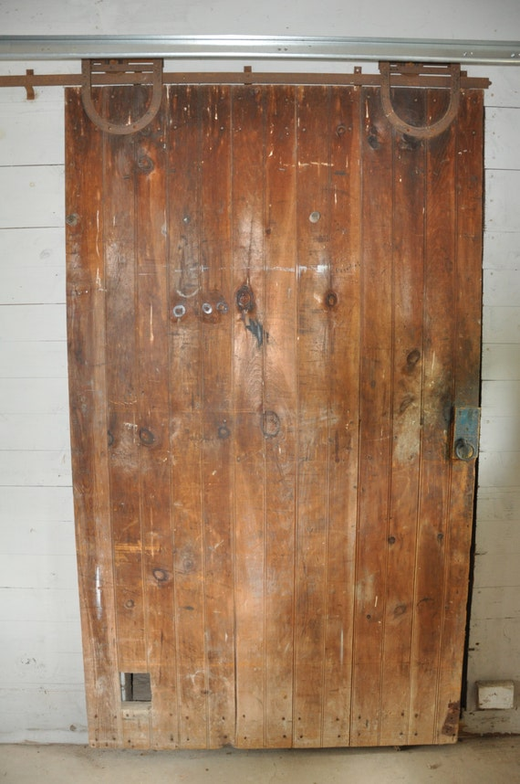 Antique wood sliding barn door cast iron track