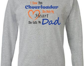Cheer dad shirt.  Long sleeve in grey. Cheer dad tshirt. I know this cheerleader, she stole my heart, she calls me dad. Cheerleader dad tee