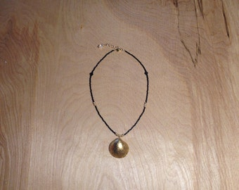 Gold Leafed Clam Shell on Black and Gold Bead Necklace
