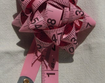 Pink tape measure pin