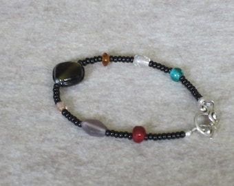 Black bead bracelet with multi colored beads