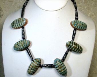 Black n Blue Necklace, OOAK by Rachelle Starr, 2014, White Dotted Black Glass Tubes and Layered Striped Seashells on Wood, Tribal Style