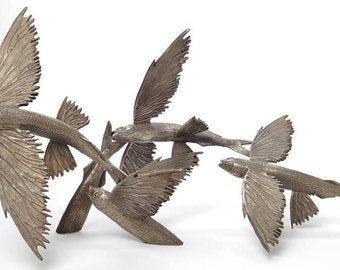Bronze sculpture grouping of flying fish by Kirk McGuire