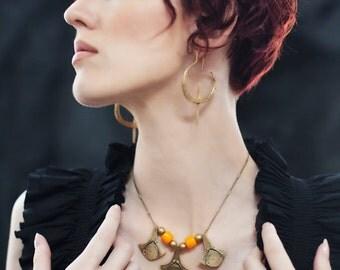 Miyu Decay Gauged Crescent Hooped Earrings in Brass