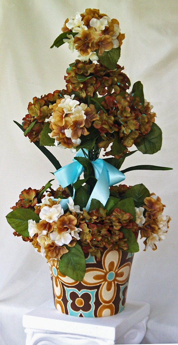 Tall silk flower arrangement brown light teal vase