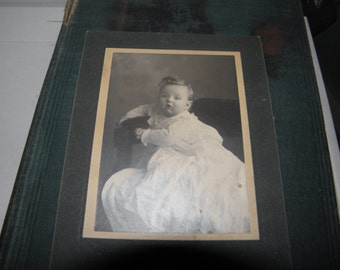 late 1800's baby photo, paper on pastboard. original not reproduction