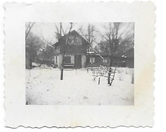House with snow covered yard. Germany. 63