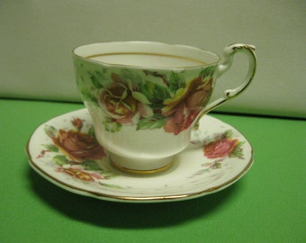 Paragon China Golden Emblem Floral Roses Tea Cup and Saucer  England