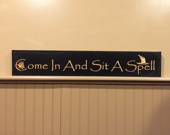 "Carved ""Come In And Sit A Spell"" sign"