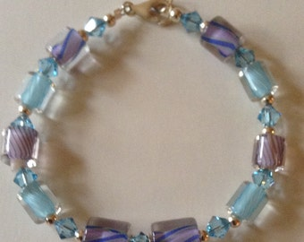 Blue David Christensen furnace glass bead with Swarovski crystal and sterling silver bead bracelet