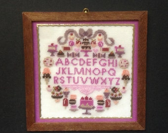 Picture in miniature with embroidered alphabet