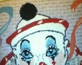 Beautiful mime needlepoint.