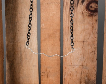 Silver Patterned metal on a thick black chain