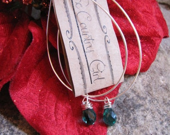 Larger grade silver plated artistic wire hoops with Teal Green Briolette beads.