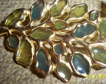 VINTAGE STAINED GLASS pin...definitely a collectible..