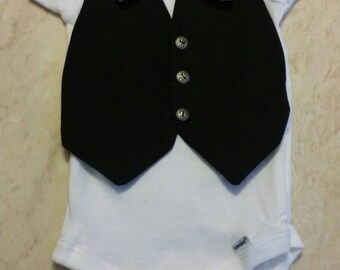 Baby vest onesie with circle bowtie.