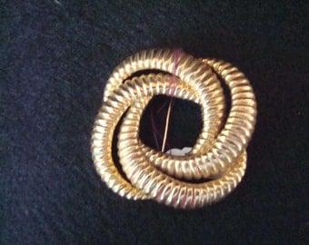 Vintage gold tone circular brooch