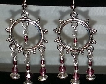 Silver earring with three dangling rods of purple beads