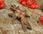Carved cross with beaten egg shell
