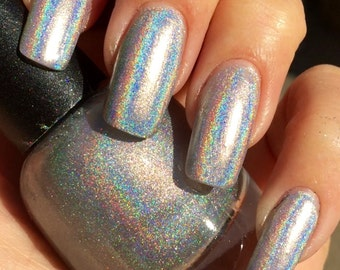 PLATINUM is a  Mega Linear Rainbow Holographic Silver Nail Polish - Limited Ed.