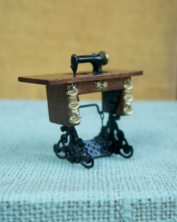 Items similar to dollhouse sewing machine table cabinet - Cast iron sewing machine table ...