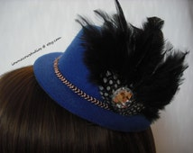 Feathered mini top hats in blue, white, and purple