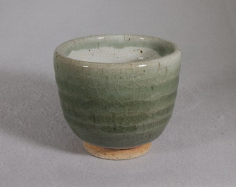 Jade colored stoneware tea bowl with throwing rings