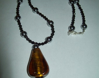 Black necklace, brown necklace, pendant, silver beads, silver necklace