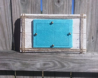 Beachy reclaimed wood picture frame. Turquoise mattng with twine.