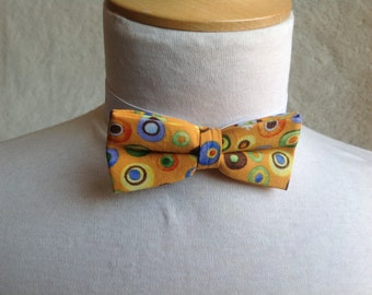 orange with multicolored dot bow tie for children