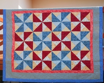 Blue-red quilt, with the colors of the sea, and with the windmills of the Netherlands