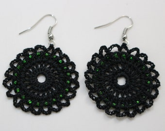 Beautifull crocheted black earring with green beads