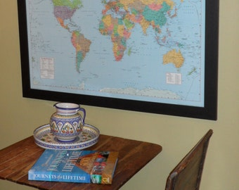 personalized colorful push pin travel world map with brass plate on a dark coffee brown frame
