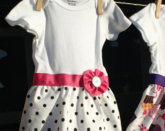 Newborn onesies: White with black polka-dots, pink ribbon