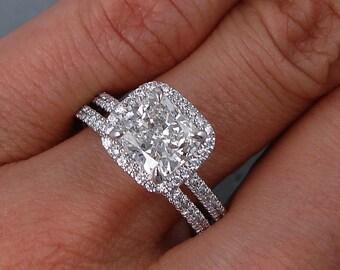 Sparkling 2.15 ctw Cushion cut diamond ring and wedding band set with a gorgeous 1.61 ct H/SI1 Clarity Enhanced Cushion cut diamond