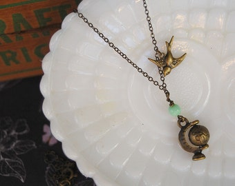aged brass spinning globe necklace with vintage mint green bead - flying bird- traveler