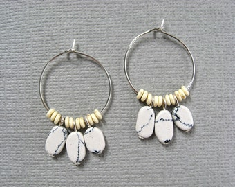 Albino Chief hoop earrings - silver plated hoops with white & black vein howlite oval drop beads and tiny ivory color rondelle spacers