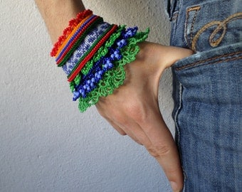 beaded crochet bracelet with orange, red, cornflower blue, indigo and kelly green beaded details
