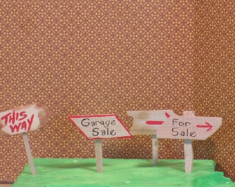 Miniature wooden yard signs