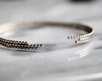 S t e l a r .silver beaded bracelet. Sterling  silver cuff