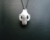 30% OFF SALE -- Cat Skull Necklace in white - A white cat skull necklace on a gunmetal chain to adorn your neck