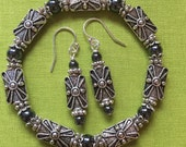 Silver and hematite bracelet and earring set