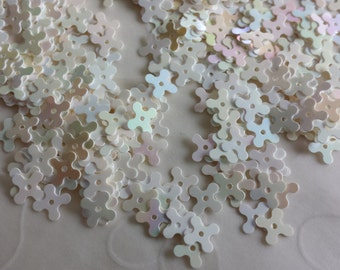 New Item -- 7 g of 7 mm 4 Petals Flower Sequins in Opaque Iridescent White Color