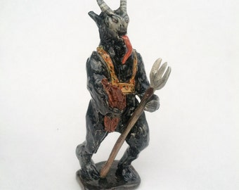 Krampus ceramic figurine for christmas.